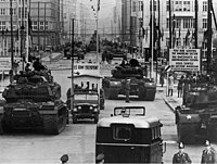 Soviet and American tanks face each other at Checkpoint Charlie during the Berlin Crisis of 1961.
