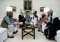President Reagan publicizes his support by meeting with Afghan Mujahideen leaders in the White House, 1983.