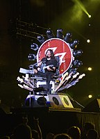 Grohl performing at Fenway Park in 2015 on a custom-built throne while recuperating from a broken leg