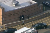 alt=Police are seen at Sandy Hook Elementary School after a school shooting.|In the Sandy Hook Elementary School shooting, Adam Lanza killed twenty children and six adults.