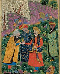 Mahmud of Ghazni (in red robe), shaking hands with a sheikh, with his companion Malik Ayaz standing behind him. (1515)