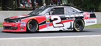 McDowell racing during his first NASCAR win at Road America
