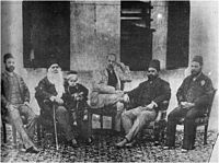 Sir Syed with his son Syed Mahmood, grand son Syed Ross Masood, and some admirers.