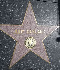 Star for recognition of film work at 1715 Vine Street on the Hollywood Walk of Fame: She has another for recording at 6764 Hollywood Boulevard.