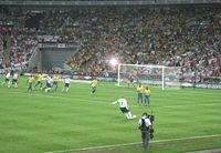 Beckham takes the free kick against Brazil from which John Terry scored