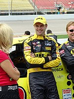 Travis standing in front of his 2004 Craftsman Truck @ Michigan International Speedway for the Line-X 200. Travis would go on to win this race giving Toyota is first win in a Nascar National Series