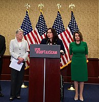 Senator Tammy Duckworth and then House Minority Leader Nancy Pelosi opposing the Tax Cuts and Jobs Act of 2017.