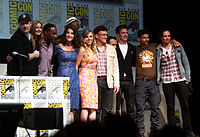 The cast and crew of Captain America: The Winter Soldier at the 2013 San Diego Comic-Con (L-R: producer Kevin Feige, VanCamp, Mackie, Smulders, Jackson, Johansson, directors Anthony and Joe Russo, Evans, Grillo, Stan)