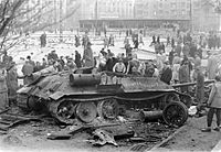 A destroyed Soviet tank in Budapest during the 1956 Revolution; Times Man of the Year for 1956 was the Hungarian Freedom Fighter