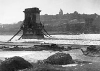 The Széchenyi Chain Bridge and the Buda Castle in ruins after World War II (1946)