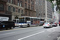 A bus outside the base of the building on 57th Street