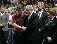 President George W. Bush comforts Virginia Tech Student Government Association President James Tyger after giving his speech at the school's convocation. Laura Bush looks on.