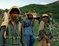 CIA-funded and ISI-trained Afghan mujahideen fighters crossing the Durand Line border to fight Soviet forces and the Soviet-backed Afghan government in 1985