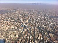 Air pollution over Mexico City in December 2010. Air quality is poorest during the winter.