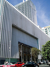 Multi-storey Sanborns department store with the façade of a 19th-century home being used as an entrance area