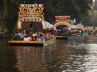 Trajineras in the canals of Xochimilco. Xochimilco and the historic center of Mexico City were declared a World Heritage Site in 1987.