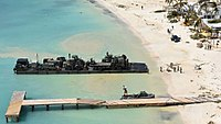 A UK Royal Logistics Corp landing raft delivers emergency relief to Anguilla