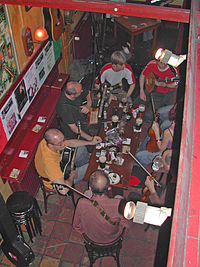 Irish music enthusiasts gather at a pub to play and drink beer