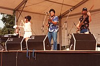 Muldaur (left) with her band on stage at the 1983 Cambridge Folk Festival, England