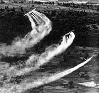 Three US Fairchild UC-123B aircraft spraying Agent Orange during the Operation Ranch Hand as part of the overall herbicidal warfare operation called Trail Dust with the aim to deprive the food and vegetation cover of the Việt Cộng, c.1962–1971.
