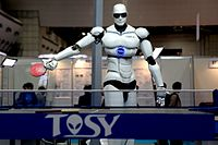 A Vietnamese-made TOPIO 3.0 humanoid ping-pong-playing robot displayed during the 2009 International Robot Exhibition (IREX) in Tokyo.