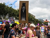 """A group of LGBT people holding up """"The Babadook"""" at the LGBT Resist March in Los Angeles."""