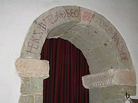 Her sƿutelað seo gecƿydrædnes ðe ('Here the Word is revealed to thee'). Old English inscription over the arch of the south porticus in the 10th-century St Mary's parish church, Breamore, Hampshire