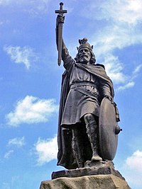 Alfred the Great statue in Winchester, Hampshire. The 9th-century English King proposed that primary education be taught in English, with those wishing to advance to holy orders to continue their studies in Latin.
