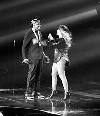 """Jay-Z embraces wife Beyoncé after his performance of """"Tom Ford"""" on The Mrs. Carter Show World Tour, 2013"""