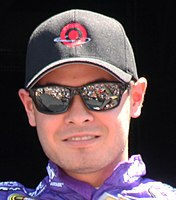 Kyle Larson won the pole position, setting a new track record.