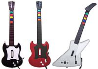The controllers bundled with Guitar Hero releases (from left to right): Gibson SGs for Guitar Hero and Guitar Hero II (PlayStation 2) and Gibson Explorer for Guitar Hero II (Xbox 360) and Guitar Hero III: Legends of Rock (PC)