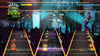 """Gameplay of a whole band in Guitar Hero World Tour playing Billy Idol's """"Rebel Yell"""". On top are vocals, bottom from left to right: lead guitar, drums and bass guitar."""