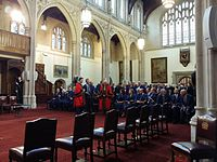 On formal occasions, as here in the Guildhall's Old Library, the Common Councilmen wear blue fur-trimmed robes.